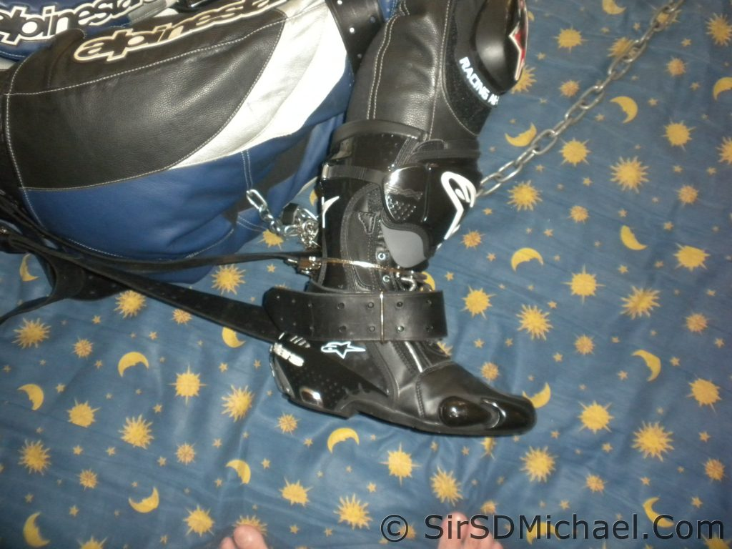 Boots and Belts - The boots are chained together, then belts added to tighten the bondage.