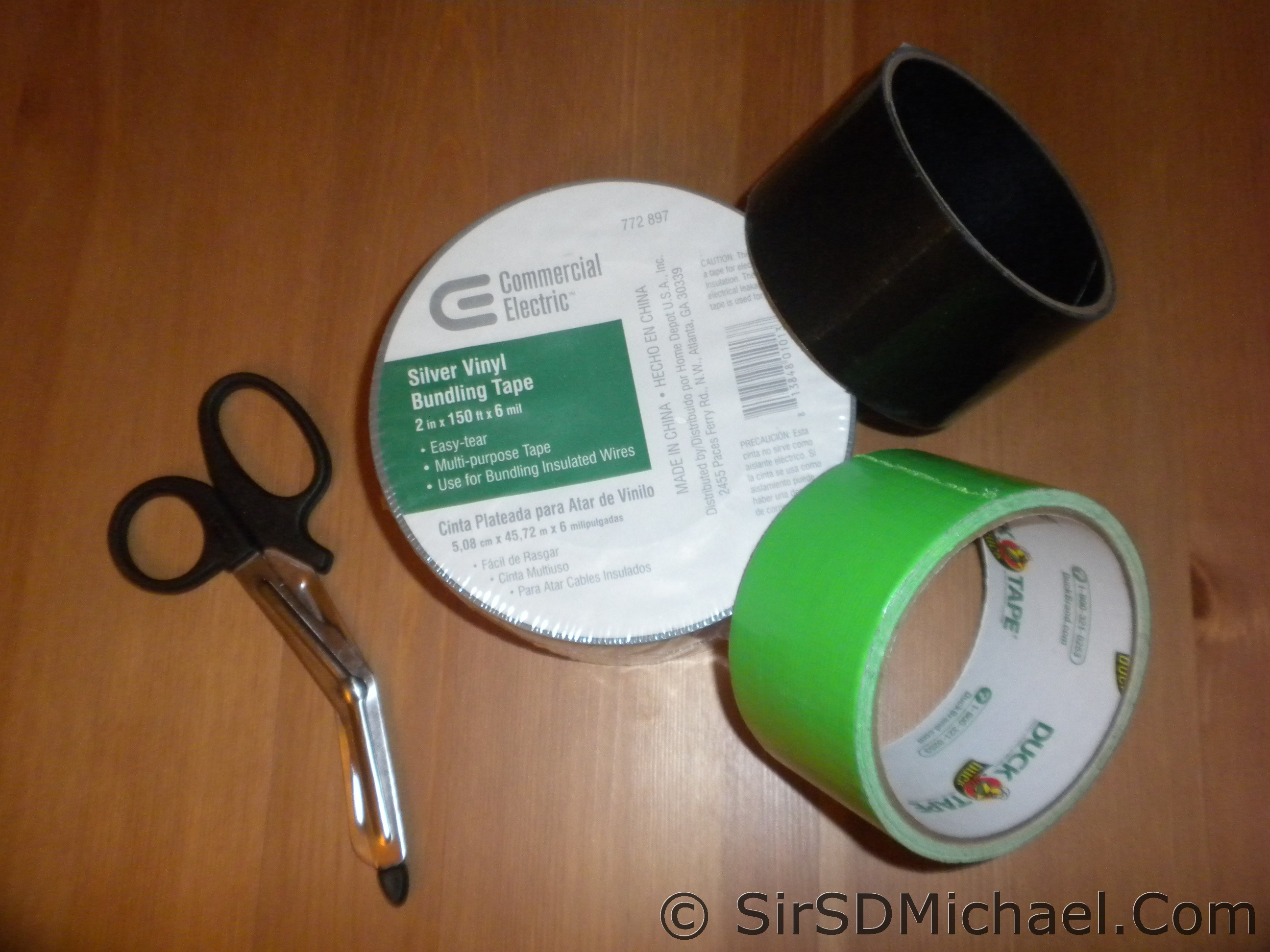 Different rolls of tape and a pair of Nurse's Scissors.
