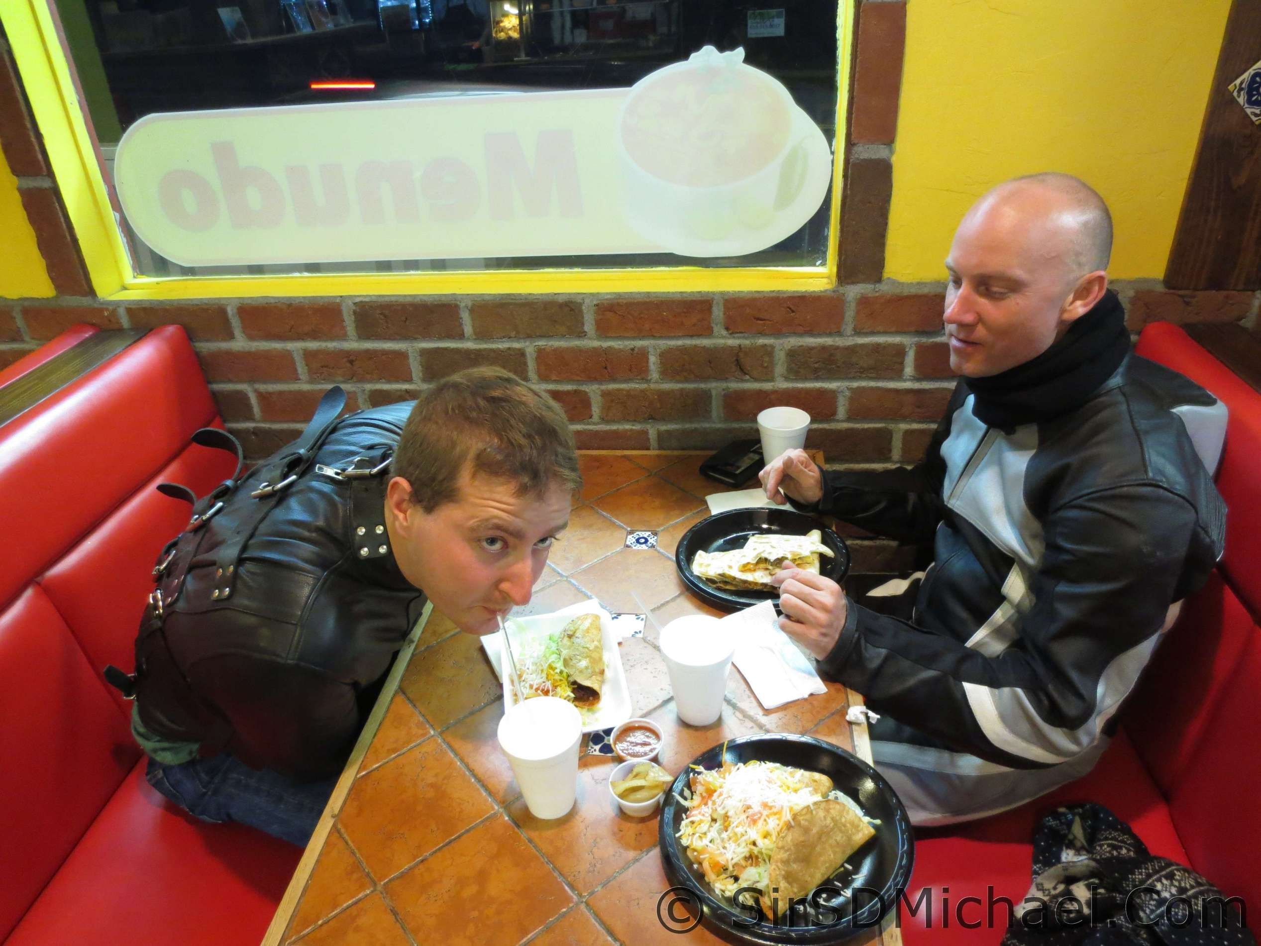 In leathers with a boy in a straitjacket having dinner.