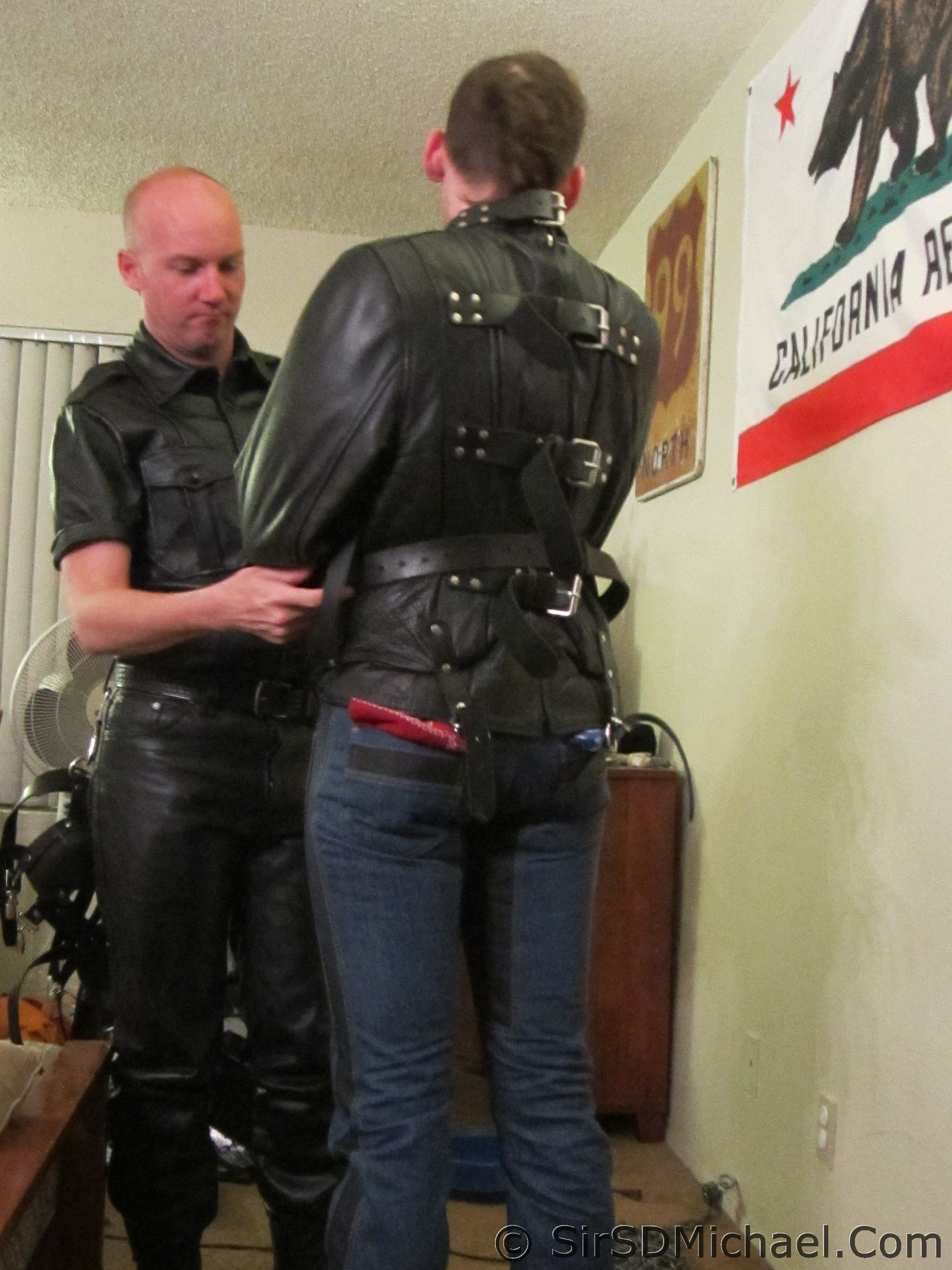 Strapping a boy into a straitjacket for a night out.