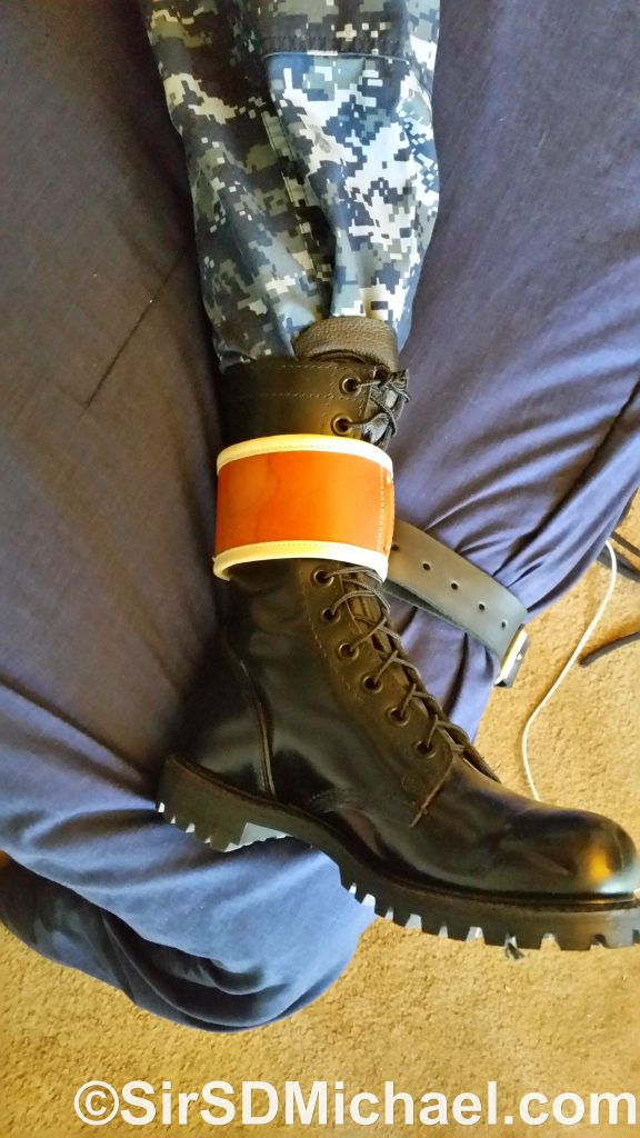 Boot strapped down with medical restraints and a belt.
